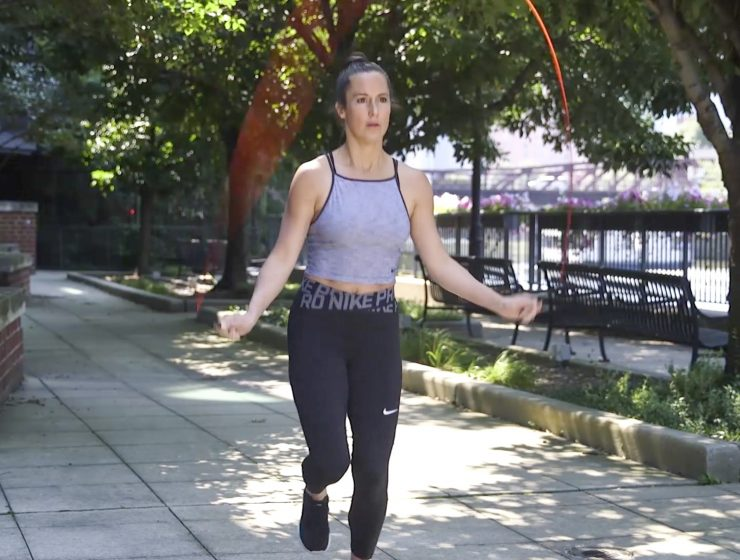 Nikki Metzger jumping rope in the park